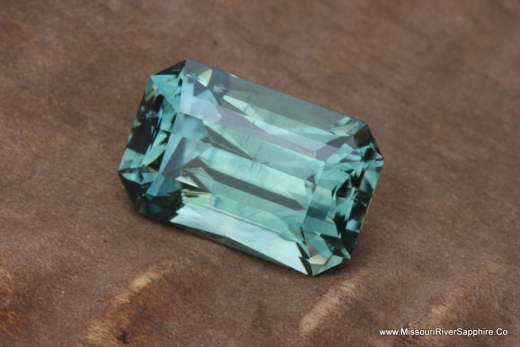 5.73ct Blueish Green Montana Sapphire Heat Only Emerald-shaped with Scissor Cut pavilion, Eye Clean